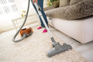 caregiver cleaning the floor